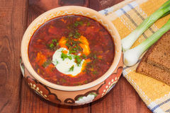 Bowl of Ukrainian borscht garnished with dill and sour cream Stock Photos