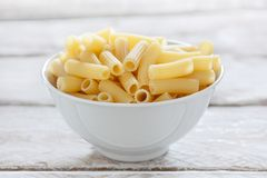 Bowl of uncooked macaroni Stock Photo