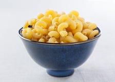 Bowl of uncooked macaroni Stock Photo