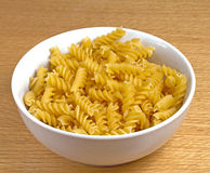 Bowl of uncooked pasta Stock Photo