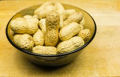 Bowl with unshelled peanuts. royalty free stock photography