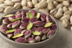 Bowl with unshelled pistachio nuts Stock Images