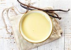 Bowl of vanilla sauce Stock Photography