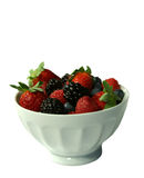 Bowl of a variety of berries. Bowl of berries isolated on white background Stock Photos