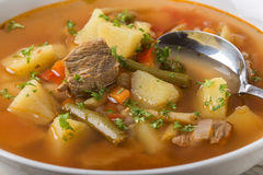 Bowl of vegetable beef soup with spoon Royalty Free Stock Images
