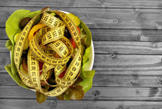 Bowl with vegetable salad and centimeter Royalty Free Stock Images