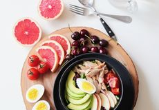 Bowl of Vegetable Salad and Fruits Stock Images