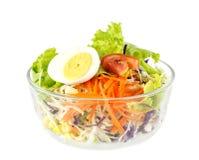 Bowl of vegetable salad on white Stock Photo
