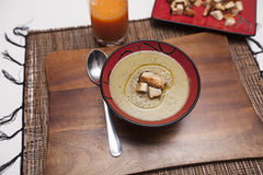 A bowl of vegetable soup. With croutons on a wooden board Royalty Free Stock Images
