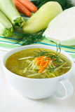 Bowl of vegetable soup with fresh vegetables Stock Photography