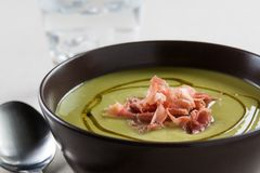 Bowl of vegetable soup with ham Stock Images