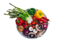 Bowl of vegetables from above isolated on white. Royalty Free Stock Image