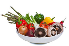 Bowl of vegetables isolated on white. Royalty Free Stock Images