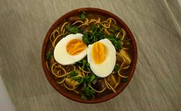 Bowl of vegetarian ramen soup with egg royalty free stock images