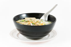 Bowl of Vietnamese pho bo,noodle soup served with onions and cil Stock Photography