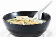 Bowl of Vietnamese pho bo,noodle soup served with onions and cil Royalty Free Stock Image