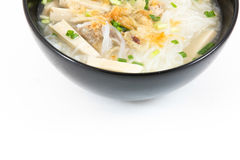 Bowl of Vietnamese pho bo,noodle soup served with onions and cil Royalty Free Stock Photos