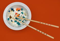 Bowl of vitamins with pills Stock Images
