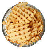 Bowl of Waffle Fries Over White Royalty Free Stock Image