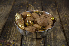Bowl of walnuts for christmas time on wooden old background. Stock Photography