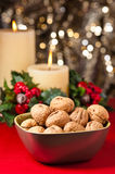 Bowl of walnuts in festive setting Stock Image