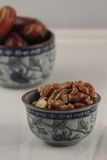 A bowl of walnuts and fig Royalty Free Stock Images
