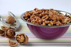 Bowl of walnuts with nutcracker Stock Photos