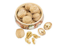 Bowl with walnuts and several nuts beside Stock Photos