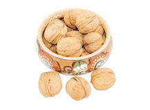 Bowl with walnuts and several nuts beside Stock Photo