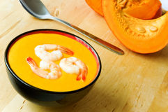 Bowl of warm pumpkin soup Stock Images