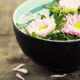 Bowl of water and flowers stock photo