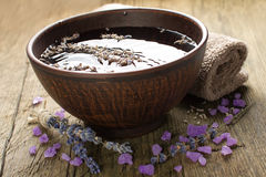 Bowl of water and lavender petals and salt Royalty Free Stock Photos