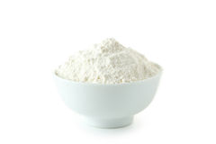 Bowl of wheat flour isolated on a white Royalty Free Stock Images