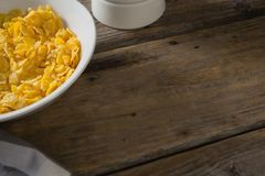 Bowl of wheaties cereal breakfast on wooden table Stock Photos