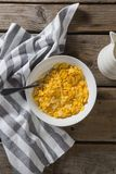 Bowl of wheaties cereal and spoon with napkin. On wooden table Stock Photos