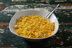 Bowl of wheaties cereal with spoon. On wooden table Royalty Free Stock Photography
