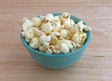 Bowl of white cheddar cheese popcorn on counter top Royalty Free Stock Image