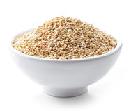 Bowl of white quinoa seeds. Bowl of healthy white quinoa seeds isolated on white stock photo