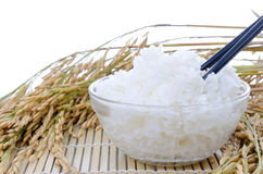 Bowl of white steamed rice with chopsticks on bamboo mat.with pa Royalty Free Stock Photography