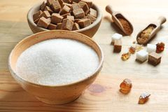 Bowl with white sugar. On wooden background Stock Images