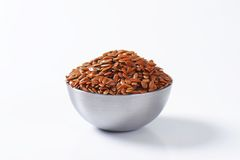 Bowl of whole brown flax seeds Stock Photos