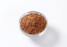 Bowl of whole brown flax seeds Stock Photography