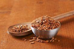 Bowl of whole brown flax seeds Royalty Free Stock Images