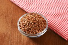 Bowl of whole brown flax seeds Stock Image
