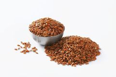 Bowl of whole brown flax seeds Stock Photo