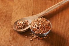 Bowl of whole brown flax seeds Royalty Free Stock Photos
