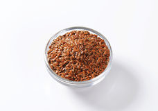 Bowl of whole brown flax seeds Royalty Free Stock Image