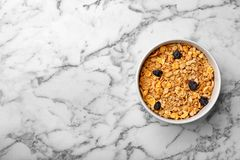 Bowl of whole grain cereal on marble table. Top view with space for text stock photos