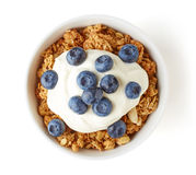Bowl of whole grain muesli with yogurt and blueberries isolated Stock Photography