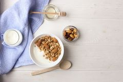 Bowl of whole grain muesli with yogurt on white background, top view stock photos
